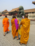 Three Saffron-Robed Monks Tour and Take Photos in the Forbidden City