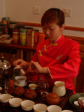 A Salesperson Prepares Samples of Tea for Tourists
