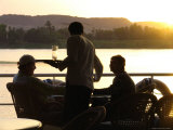 A Waiter Serves Drinks Aboard a Sunset Cruise on the Nile River