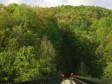 Cyclists Cross a Bridge on the Youghiogheny River Trail
