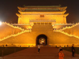 Children Play Soccer in Front of a Floodlit Gate on Tiananmen Square