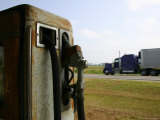 The Blur of a Truck Passing a Vintage Gas Pump
