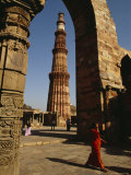 The 239-Foot Tall Qutab Minar Seen Through the Arch of a Mosque Ruin