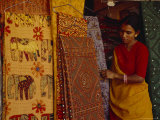 Woman Looks at Traditional Indian Fabrics with Patches and Stitching