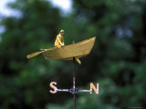A Weather Vane with a Rowboat and Skipper Figurine Atop It