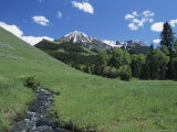 Scenic Gallatin Mountains with a Stream Running Through a Meadow