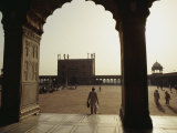 A Man Walks into the Courtyard of the Jama Masjid  or Friday Mosque  Built Between 1644