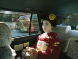 Kimono-Clad Geisha Sits in the Back of a Cab
