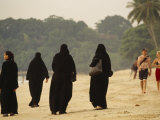 Middle Eastern Muslim Women and Westerners Stroll Along Penang Beach