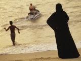 Middle Eastern Woman Watches Jet-Skier from Penang Beach