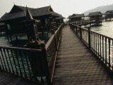 Walkway to Malaysian-Style Luxury Resort Villas on Stilts