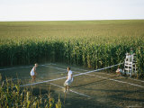 An Umpire Watches a Game on a Tennis Court Carved from a Cornfield