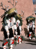Native American Men Perform a Deer Dance in Costume