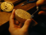 In Singapore a Goldsmith Restores the Bottom of Gold Filigree Box  Whose Top Lies on His Workbench