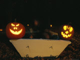 Illuminated Jack-O-Lanterns on the Back of a Rowboat