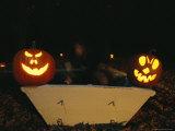 Illuminated Jack-O-Lanterns on the Back of a Rowboat