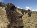Five Solemn Moai on the Grass-Covered Flank of a Dead Volcano  Rano Raraku  Easter Island