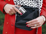 Woman Slipping a Pistol into Her Purse  Colorado