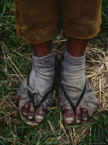 A Sulfur Miner Wears Slippers and Worn Fabric with Holes for Socks