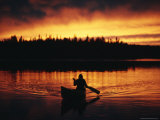 Silhouetted Canoeist on the Water at Sunset
