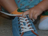 A Toddler Tries to Tie a Shoe