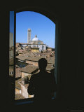 A Man Silhouetted in a Window Overlooking the Cathedral in Siena