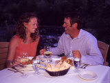 A Young Couple Eats Dinner by a Riverside  Steamboat Springs  Colorado