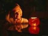 A Woman Illuminated by a Halloween Jack-O-Lantern
