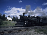 A Steam Engine Passes Through a Station in the Mountains  Cumbres Pass  Colorado