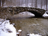 An Old Stone Bridge Over Rock Creek During a Snow Storm