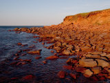 The Almost Unnatural Red of Rocks of Island Light up at Sunset  Prince Edward Island  Canada