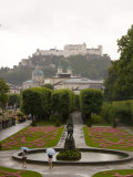 Tourists Enjoy a Rainew York Day in the Gardens of the Palace  Salzburg  Austria