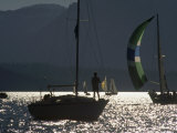 Backlit Boater Observes a Sailboat Race on Lake Tahoe  California