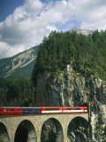 A Train Passes into a Tunnel in the Mountains of Switzerland