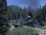 A Steam Engine Chugs Through a Mountain Pass in the Rockies  Cumbres Pass  Colorado