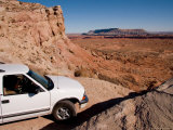 A Sport Utility Vehicle Maneuvers a Tight Corner on a Dirt Trail  Capitol Reef National Park  Utah