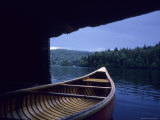 A Canoe Sticks Out of a Boathouse on an Early Morning Day  Quebec  Canada