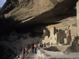 Tourists Admire the Ancient Anasazi Ruins of Mesa Verde  Colorado
