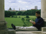 A Man Reads in the English Garden in Munich
