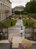 Tourists Wander Through the Bishop&#39;s Gardens in Salzburg in the Rain  Salzburg  Austria