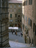 A Street Scene at the Foot of the Siena Cathedral