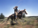 Cowboy Riding Through the Desert of Central Oregon  USA