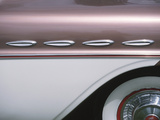 Sleek Chrome Decorations on Side of Pink Classic Car