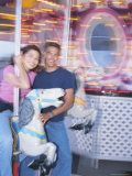 Young Couple Riding Carousel