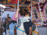 Young Couple Kissing on Carousel