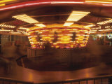 Fun on a Spinning Carousel at Night