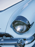 Vintage Headlight on Antique Blue Car