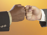 Businessmen Hitting Each Other's Fists