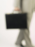 Blur of Businessman Walking with Briefcase