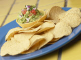 Tasty Nacho Chips Beside Bowl of Fresh Guacamole